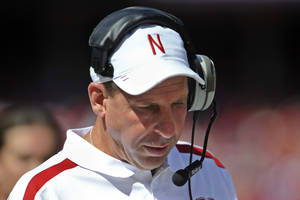 Photo -   Nebraska head coach Bo Pelini looks down in the first half of an NCAA college football game against Arkansas State in Lincoln, Neb., Saturday, Sept. 15, 2012. Pelini left the game by ambulance after falling ill on the sideline in the first half. (AP Photo/Dave Weaver)
