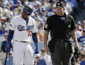 Photo - Los Angeles Dodgers' Hanley Ramirez argues a strike three call by home plate umpire Ted Barrett during the first inning of Game 5 of the National League baseball championship series against the St. Louis Cardinals Wednesday, Oct. 16, 2013, in Los Angeles. (AP Photo/David J. Phillip)