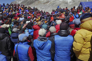 Photo - This April 24, 2014 photo released by Adrian Ballinger, founder and head guide of Alpenglow Expeditions, shows a meeting between Nepalese government delegation and Sherpa mountain guides near Everest base camp, Nepal. Nepal's attempts to salvage the Mount Everest climbing season took another hit Friday as more Sherpa mountain guides packed and left the base camp for their village homes a week after the deadliest disaster on the world's highest mountain. (AP Photo/Alpenglow Expeditions, Adrian Ballinger)