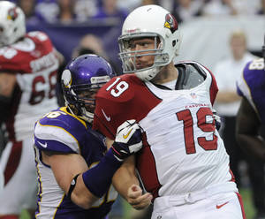 Photo -   Minnesota Vikings defensive end Brian Robison (96) hits Arizona Cardinals quarterback John Skelton (19) in the first half of an NFL football game in Minneapolis, Sunday, Oct. 21, 2012. (AP Photo/Jim Mone)