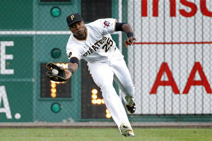 Photo - Pittsburgh Pirates right fielder Gregory Polanco (25) catches a fly ball by Arizona Diamondbacks' Ender Inciarte during the first inning of a baseball game in Pittsburgh Wednesday, July 2, 2014. (AP Photo/Gene J. Puskar)