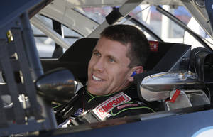 Photo - Driver Carl Edwards smiles after he took the pole for Sunday's NASCAR Sprint Cup series auto race at the Texas Motor Speedway in Fort Worth, Texas, Friday, Nov. 1, 2013.  (AP Photo/LM Otero)