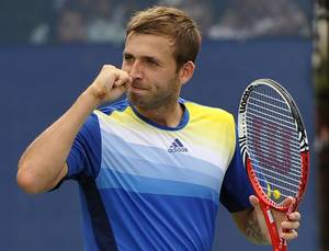 Photo - Daniel Evans, of Great Britain, reacts after beating Kei Nishikori, of Japan, during the first round of the 2013 U.S. Open tennis tournament, Monday, Aug. 26, 2013, in New York. (AP Photo/Kathy Kmonicek)