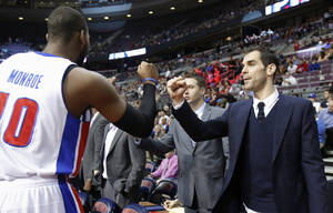 photo - Detroit Pistons guard Jose Calderon, right, gets a fist bump from center Greg Monroe (10) before the Pistons' NBA basketball game against the Cleveland Cavaliers on Friday, Feb. 1, 2013, in Auburn Hills, Mich. Calderon was acquired in a trade from the Toronto Raptors but did not play Friday. (AP Photo/Duane Burleson)