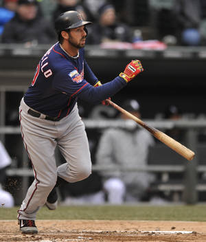 Photo - Minnesota Twins' Chris Colabello watches his 3-RBI double during the third inning of an baseball game against the Chicago White Sox in Chicago, Thursday, April 3, 2014. (AP Photo/Paul Beaty)