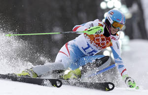 Photo - Silver medalist Austria's Nicole Hosp passes a gate in the slalom portion of the women's supercombined at the Sochi 2014 Winter Olympics, Monday, Feb. 10, 2014, in Krasnaya Polyana, Russia. (AP Photo/Luca Bruno)