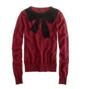 "Photo - This undated publicity photo provided by J.Crew shows a crewneck sweater decorated with an oversized bow motif at the neckline by J.Crew. The good, the bad, the kitschy. A ""seasonal sweater"" is one way to start a conversation at a holiday function. (AP Photo/J.Crew)"