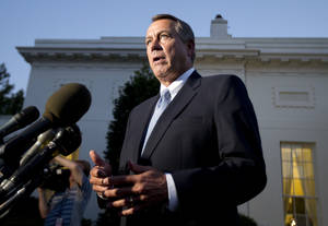 Photo - House Speaker John Boehner, R-Ohio, speaks to reporters following a meeting with President Barack Obama at the White House in Washington, Wednesday, Oct. 2, 2013.  (AP Photo/Manuel Balce Ceneta)
