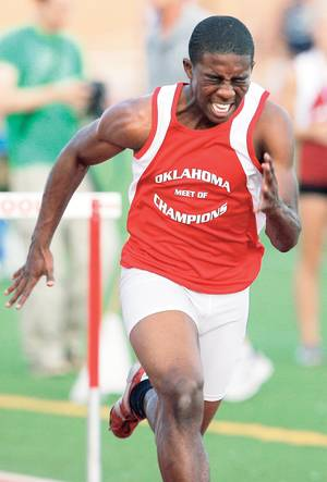 Photo - Del City's Airick Johnson races to the finish on his way to winning the boys 110-meter hurdles during the Meet of Champions track and field event at Moore High School. PHOTO BY NATE BILLINGS, THE OKLAHOMAN