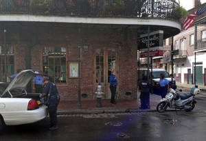 Photo - CORRECTS ACTIVITY SHOWN IN SCENE - Authorities continue working the scene along Bourbon Street after a shooting, early Sunday, June 29, 2014, in New Orleans. Nine people were shot on Bourbon Street in New Orleans' celebrated French Quarter, leaving at least one person in critical condition. (AP Photo/NOLA.com/The Times-Picayune, Benjamin Alexander-Bloch) MAGS OUT; NO SALES; USA TODAY OUT; THE BATON ROUGE ADVOCATE OUT