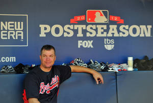 Photo -   Atlanta Braves' Chipper Jones takes a break in the dugout batting practice at Turner Field Thursday, Oct. 4, 2012, in Atlanta. The Braves take on St. Louis Cardinals in the NL wild-card baseball game on Friday. (AP Photo/Atlanta Journal-Constitution, Brant Sanderlin) MARIETTA DAILY OUT; GWINNETT DAILY POST OUT; LOCAL TV OUT; WXIA-TV OUT; WGCL-TV OUT