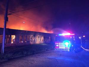 Photo -  Police arrested four juveniles Friday afternoon in connection with a fire at the old Banner School building in Guthrie. The building caught fire at about 3:50 a.m. Friday. Photo provided  <strong> -  Photo provided </strong>