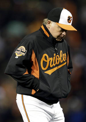 Photo -   Baltimore Orioles manager Buck Showalter walks off the field after relieving starting pitcher Jason Hammel in the sixth inning of Game 1 of the American League division baseball series against the New York Yankees on Sunday, Oct. 7, 2012, in Baltimore. New York won 7-2. (AP Photo/Patrick Semansky)
