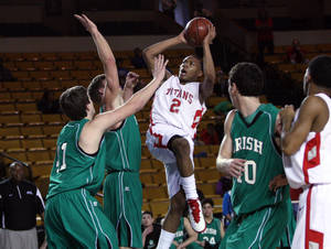 Photo - Carl Albert's Carlbe Ervin (2) shoots past a host of Bishop McGuinness players, at the Mabee Center, on Friday, Mar. 9, 2012. CORY YOUNG/Tulsa World