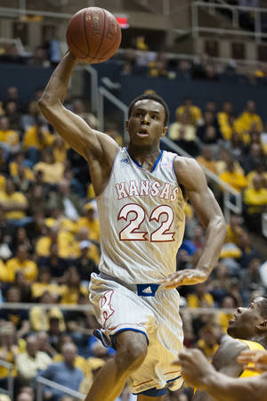 Photo - Kansas' Andrew Wiggins (22) drives to the basket during the first half of an NCAA college basketball game against West Virginia, Saturday, March 8, 2014, in Morgantown, W.Va. (AP Photo/Andrew Ferguson)