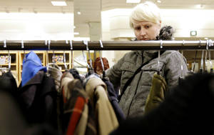 photo - In this Thursday, Jan. 20, 2013, photo, a woman shops at a Nordstrom store in Chicago. U.S. consumer confidence plunged in January to its lowest level in more than a year, reflecting higher Social Security taxes that left Americans with less take-home pay.  (AP Photo/Nam Y. Huh)