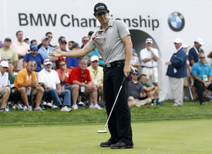 photo -   Rory McIlroy, of Northern Ireland, gestures on the 15th hole during the BMW Championship PGA golf tournament at Crooked Stick Golf Club in Carmel, Ind., Sunday, Sept. 9, 2012. McIlroy won the event. (AP Photo/Charles Rex Arbogast)  