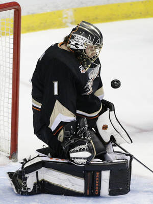 Photo - Anaheim Ducks goalie Jonas Hiller, of Switzerland, makes a save during the first period of an NHL hockey game against the Winnipeg Jets, Tuesday, Jan. 21, 2014, in Anaheim, Calif. (AP Photo/Jae C. Hong)