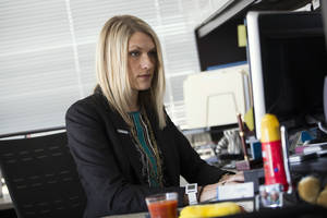 Photo -      Nida Degesys, National President of the American Medical Student Association, works at her office in Sterling, Va. Degesys graduated in May 2013 from Northeast Ohio Medical University with about $180,000 in loans. The amount has already swelled with interest to about $220,000. AP Photo  <strong>Evan Vucci -  AP </strong>