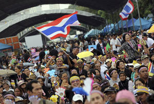 Photo - In this Nov. 11, 2013 photo, anti-government protesters gather to listen speeches at the Democracy Monument in Bangkok, Thailand. Anti-government protesters are planning to shut down Thailand's capital on Monday, Jan. 13, 2014 by blocking traffic at key intersections, providing a fitting metaphor for the country's politics: no way forward, no backing out. (AP Photo/Apichart Weerawong)