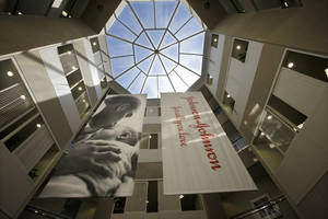 Photo - In this Tuesday, July 30, 2013, photo, large banners hang in an atrium at the headquarters of Johnson & Johnson in New Brunswick, N.J. Johnson & Johnson reports quarterly financial results before the market opens on Tuesday, Jan. 21, 2014. (AP Photo/Mel Evans)