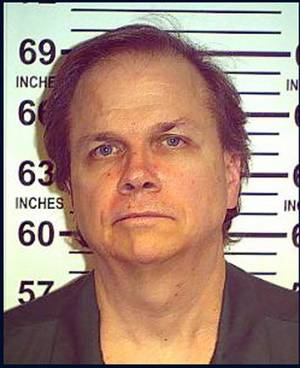 Photo - FILE - This May 15, 2012 file photo provided by the New York State Department of Corrections shows Mark David Chapman at the Wende Correctional Facility in Alden, N.Y.  Four letters from John Lennon's killer to the New York police officer who arrested him are on sale through a Los Angeles auction house. Gary Zimet, owner Moments in Time, said the letters from Mark David Chapman to Stephen Spiro are for sale starting Monday, Feb. 18, 2013 for a fixed price of $75,000. Zimet says he is selling the letters on behalf of Spiro, who arrested Chapman on Dec. 8, 1980, shortly after Lennon was shot outside his Manhattan building.  (AP Photo/New York State Department of Corrections, File)