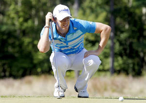 Photo -   Rory McIlroy, of Northern Ireland, lines up a putt on the fourth hole during the final round of the Deutsche Bank Championship PGA golf tournament at TPC Boston in Norton, Mass., Monday, Sept. 3, 2012. (AP Photo/Michael Dwyer)