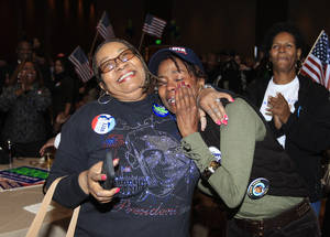 Photo -   Anita Flanigan, left, and Renee Drake react after President Obama reaches the 270 Electoral College votes during the Michigan Democratic election night party at the MGM Grand Detroit, following Election Day, early Wednesday, Nov. 7, 2012. (AP Photo/Carlos Osorio)