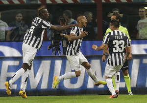 Photo - Juventus midfielder Arturo Vidal, of Chile, center, jumps in celebration after scoring while teammates Juventus midfielder Paul Pogba, of France,  left, and Juventus midfielder Mauricio Isla, of Chile, reach out to congratulate him, during a Serie A soccer match between Inter Milan and Juventus, at the San Siro stadium in Milan, Italy, Saturday, Sept. 14, 2013. (AP Photo/Luca Bruno)