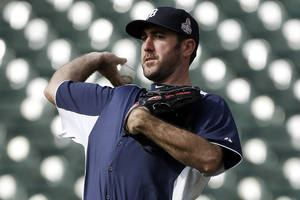 Photo -   Detroit Tigers pitcher Justin Verlander throws during a workout at Comerica Park in Detroit, Monday, Oct. 22, 2012. When Dave Dombrowski first took over as president of the Detroit Tigers, they lost 225 games his first two seasons. But in 2004, Detroit drafted Justin Verlander, the first step toward building one of baseball's glamour teams in the heart of the Motor City. The Tigers will play the winner of the San Francisco Giants-St. Louis Cardinals National League Championship Series in the World Series. (AP Photo/Paul Sancya)