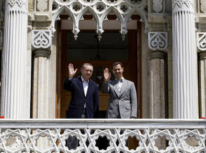 Photo -   FILE - In this May 9, 2010 file photo, Syrian President Bashar Assad, right, and Turkish Prime Minister Recep Tayyip Erdogan wave to the media before a meeting at the Ottoman-era Ciragan Palace in Istanbul, Turkey. Mustafa Kemal Ataturk, Turkey's independence war hero, national founder in a time of crisis, imposer of secular ideas on a mostly Muslim population and a hallowed presence long after his death. The cult of Ataturk, once a staple of Turkish state ideology, is slowly, sometimes imperceptibly, being diluted, replaced in part by the Ottoman imperial era as inspiration for a government with its own set of ideas about modernity, morality and regional stature.(AP Photo/Ibrahim Usta, File)