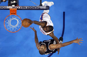 Photo - Kevin Durant (35) dunks over San Antonio's Tim Duncan (21) during Game 3 of the Western Conference Finals between the Oklahoma City Thunder and the San Antonio Spurs in the NBA playoffs at the Chesapeake Energy Arena in Oklahoma City, Thursday, May 31, 2012.  Photo by Sarah Phipps, The Oklahoman