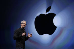 Photo - FILE - In  this Wednesday, Sept. 12, 2012, file photo, Apple CEO Tim Cook soeaks during an introduction of the new iPhone 5 in San Francisco. Cook got a relatively modest $4.2 million in pay for 2012, after the company's board set him up with stock now worth $510 million for taking the reins in 2011.  (AP Photo/Eric Risberg, File)