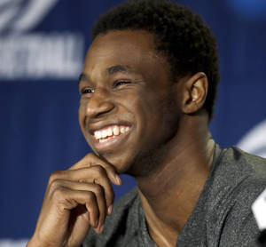 Photo - Kansas' Andrew Wiggins laughs at question during a news conference for the third-round game of the NCAA college basketball tournament Saturday, March 22, 2014, in St. Louis. Kansas is scheduled to play Stanford on Sunday. (AP Photo/Jeff Roberson)