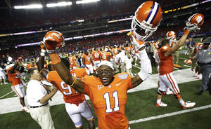 Photo -   Clemson players including safety Travis Blanks (11) celebrate a 26-19 win over Auburn in a NCAA college football game at the Georgia Dome in Atlanta Saturday, Sept. 1, 2012. (AP Photo/Dave Martin)