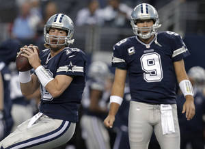 Photo - In this Nov. 28, 2013, photo, Dallas Cowboys quarterbacks Kyle Orton (18) and Tony Romo (9) warm up for an NFL football game against the Oakland Raiders in Arlington, Texas. Orton will make his first start at quarterback in his two seasons with the Cowboys on Sunday night, Dec. 29, unless Romo can recover from a herniated disc. Dallas will be playing a winner-take-all game at home against the Philadelphia Eagles for the NFC East title and a playoff berth. (AP Photo/Brandon Wade)