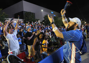 photo - Matt Westphalan, right, cheers with fans at Thunder Alley during the Oklahoma City's first-round series against Dallas. Photo by Garett Fisbeck, For The Oklahoman