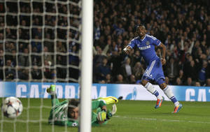 Photo - Chelsea's Samuel Eto'o, right, watches his shot go past Galatasaray's goalkeeper Fernando Muslera as he scores the opening goal during the Champions League last 16 second leg soccer match between Chelsea and Galatasaray at Stamford Bridge stadium in London, Tuesday, March 18, 2014. (AP Photo/Matt Dunham)