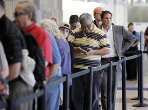 photo - Passengers wait in line for security at Will Rogers World Airport in Oklahoma City. PHOTOS BY NATE BILLINGS, THE OKLAHOMAN