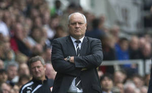 Photo - Fulham's manager Martin Jol watches their English Premier League soccer match against Cardiff City at the Craven Cottage stadium, in London, Saturday, Sept. 28, 2013. (AP Photo/Bogdan Maran)
