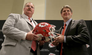 Photo - New Kansas City Chiefs NFL team head football coach Andy Reid, left, and owner Clark Hunt pose for photographers during a news conference at Arrowhead Stadium Monday, Jan. 7, 2013, in Kansas City, Mo. (AP Photo/Charlie Riedel)