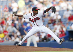 Photo - Atlanta Braves starting pitcher Julio Teheran works in the first inning of a baseball game against the New York Mets in Atlanta, Wednesday, July 2, 2014. (AP Photo/John Bazemore)