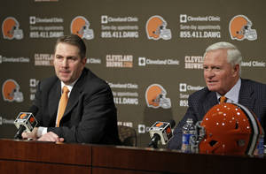 Photo - Cleveland Browns owner Jimmy Haslam, right, answers qustions at a news conference announcing Rob Chudzinski, left, as the new head coach at the NFL football team's practice facility in Berea, Ohio Friday, Jan. 11, 2013. (AP Photo/Mark Duncan)