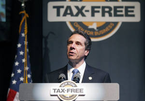 "Photo - New York State Governor Andrew M. Cuomo announces the ""Tax-Free NY"" during a press conference at the Center for Arts on the University of  Buffalo campus, in Amherst, N.Y., on Wednesday, May 22, 2013.(AP Photo/The Buffalo News, Harry Scull Jr.) TV OUT; MAGS OUT; MANDATORY CREDIT; BATAVIA DAILY NEWS OUT; DUNKIRK OBSERVER OUT; JAMESTOWN POST-JOURNAL OUT; LOCKPORT UNION-SUN JOURNAL OUT; NIAGARA GAZETTE OUT; OLEAN TIMES-HERALD OUT; SALAMANCA PRESS OUT; TONAWANDA NEWS OUT"