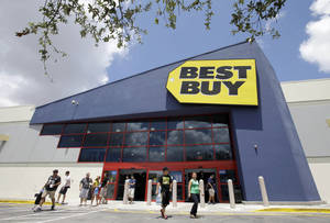 Photo - FILE - In this Monday, Aug. 19, 2013 file photo, shoppers walk toward the parking lot at a Best Buy store in Hialeah, Fla. On Thursday, Feb. 27, 2014, Best Buy reports quarterly earnings. (AP Photo/Alan Diaz, File)