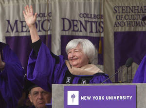 Photo - Federal Reserve Chair Janet Yellen waves to the crowd at New York University's commencement ceremony Wednesday, May 21, 2014, at Yankee Stadium in New York.  (AP Photo/Frank Franklin II)