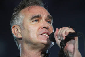 "Photo - FILE - In this July 21, 2012 file photo, British rock singer Morrissey, the former front man of the alternative rock group The Smiths, sings during his concert in Tel Aviv, Israel. Animal rights activist and singer Morrissey said he's canceled an appearance Tuesday, Feb. 26, 2013, on Jimmy Kimmel's talk show because cast members of A&E's ""Duck Dynasty"" also were scheduled to appear. (AP Photo/Dan Balilty, File)"