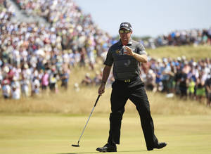 Photo - Lee Westwood of England reacts after putting on the 12th green during the second round of the British Open Golf Championship at Muirfield, Scotland, Friday July 19, 2013. (AP Photo/Peter Morrison)