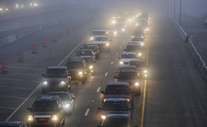 Photo - Traffic backs up Tuesday morning in Oklahoma City. Photo by Paul B. Southerland, The Oklahoman