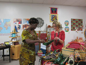 Photo - Alice Iddi-Gubbels and Jane Wheeler look at items for sale at the Pambe Ghana Fair Trade Global Market at 6516 N Olie. Photo by Carla Hinton, The Oklahoman <strong></strong>
